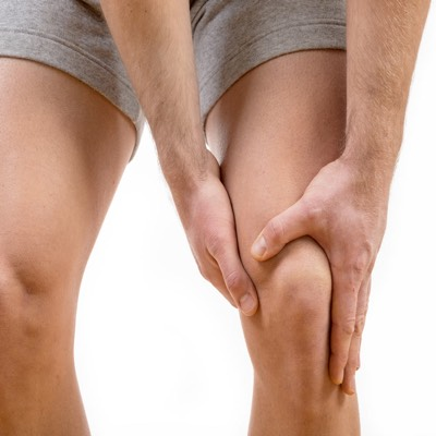 man holding sore knee